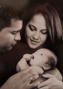 In happier times; Mr. and Mrs. Munoz with their first child. And she really wanted her second child to die with her?