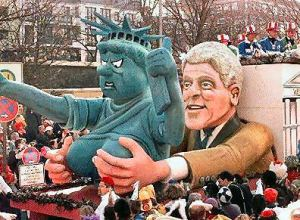 Racist float? Why not? Well, a) Bill Clinton's not black b) it's not a 4th of July parade, c) this is in Germany and d) it's not Obama.