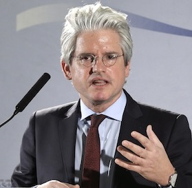 Yes, David Brock really does wear his hair like that, and yes, I admit being biased against anyone who does.