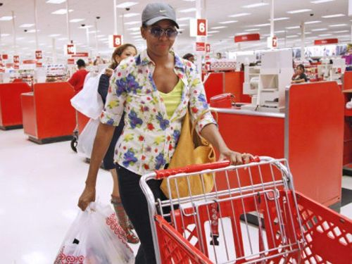 The First Lady at Target, whose skin color obviously led a shopper at Target to ignore the blouse, cart, shopping cart, purse and sunglasses and assume that she was a minimum wage target employee who just wasn't wearing her red shirt today, because whites are such racists. It's amazing she wasn't shot, when you come to think of it. No really. Amazing.