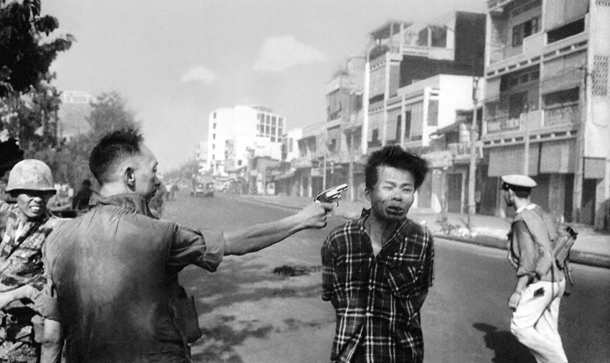 South Vietnamese National Police Chief Brig Gen. Nguyen Ngoc Loan executes a Viet Cong officer with a single pistol shot in the head in Saigon Feb. 1, 1968. Carrying a pistol and wearing civilian clothes, the Viet Cong guerrilla was captured near Quang Pafgoda, identified as an officer and taken to the police chief. (AP Photo/Eddie Adams)