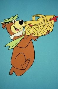 There are no good pictures of Jean stealing a loaf of bread, but here's Yogi Bear stealing a picnic basket...