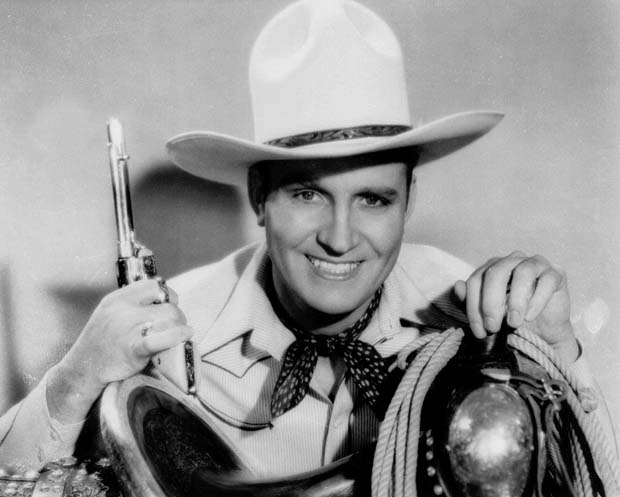 ORG XMIT: NY21 Singing cowboy star Gene Autry is shown in an undated file photo. Autry, who parlayed a $5 mail order guitar into a career as Hollywood's first singing cowboy, died Friday, Oct. 2, 1998. He was 91. His death came less than three months after the death of his great rival, Roy Rogers.