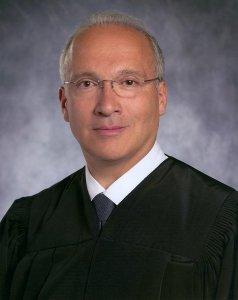 Judge Curial. Funny, he looks white to me...