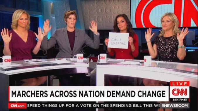 cnn-newsroom-hands-up