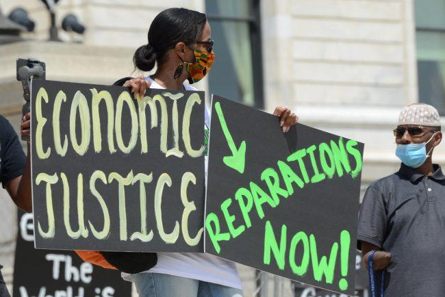 BLM_Protest_sign_2020-06-19_Credit_Fibonacci_Blue_via_Flickr-650x434